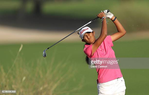 Aditi Ashok of India plays her third shot on the 10th hole during the delayed second round of the 2016 Omega Dubai Ladies Masters on the Majlis...