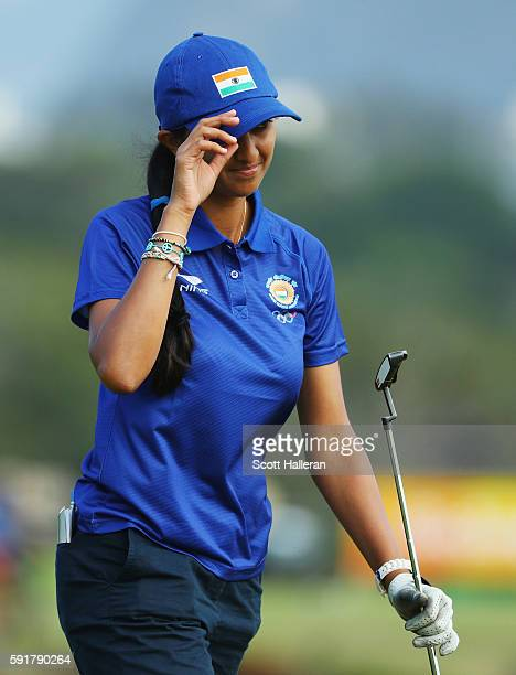 Aditi Ashok of India waves to the gallery on the fourth hole during the second round of the Women's Individual Stroke Play golf on Day 13 of the Rio...