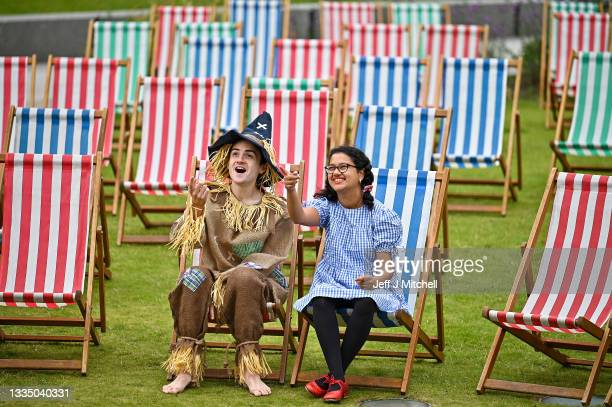 Aditi Jehangir as Dorothy, Ewan Shand as Scarecrow promote this year's Film Fest in the City in St Andrew Square on August 19, 2021 in Edinburgh,...