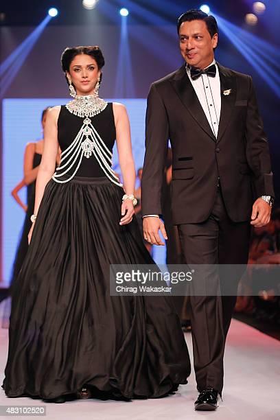 Aditi Rao Hydari Madhur Bhandarkar walk the runway at the Yoube Jewellery Ltd show during Day 4 of the India International Jewellery Week at the...