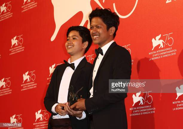 Aditya Ahmad poses with the Orizzonti Award for Best Short Film Award for Kado at the Winners Photocall during the 75th Venice Film Festival on...