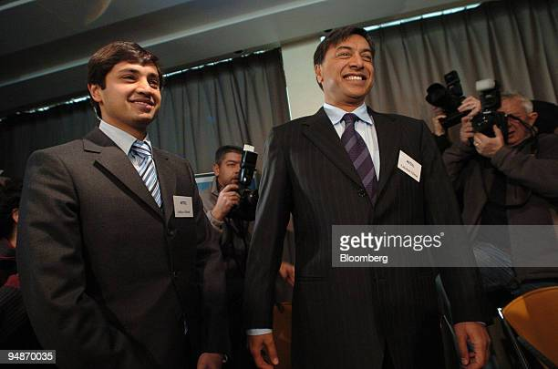 Aditya Mittal group financial officer left poses with Lakshmi Mittal chairman and chief executive of Mittal Steel Co at a press conference in the...