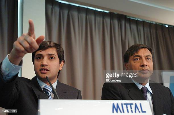 Aditya Mittal group financial officer left speaks at the Mittal press conference watched by Lakshmi Mittal chairman and chief executive of Mittal...