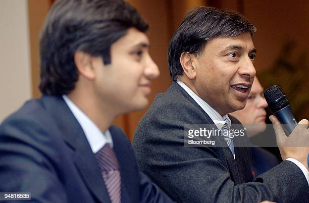 Aditya Mittal left group financial officer of Mittal Steel Co and Lakshmi Mittal chairman and chief executive officer are seen during a press...
