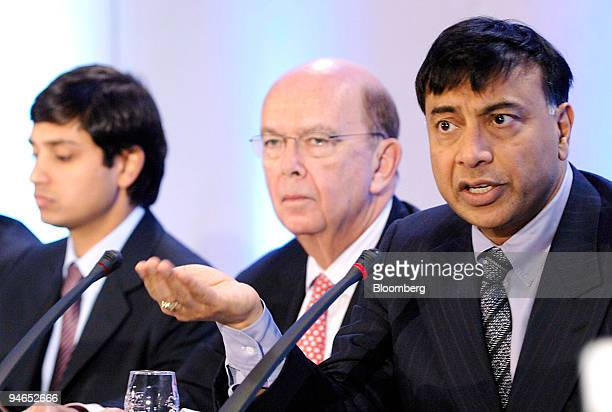Aditya Mittal left Mittal Steel Co chief financial officer and president and Wilbur L Ross center Mittal Steel board member listen as Lakshmi Mittal...