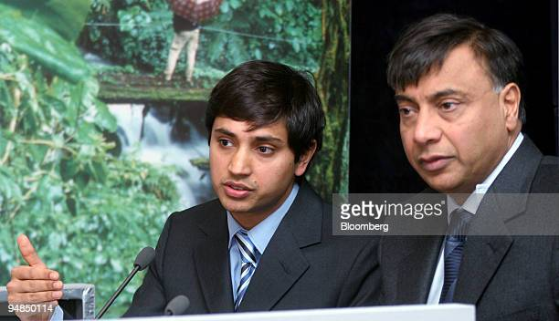 Aditya Mittal president and chief financial officer left and Lakshmi Mittal chairman and chief executive officer Mittal Steel Co are seen at a news...