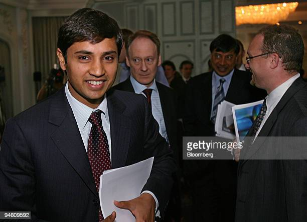 Aditya Mittal president and chief financial officer of Mittal Steel Co left smiles as he arrives at a news conference in London June 13 2006 Mittal...