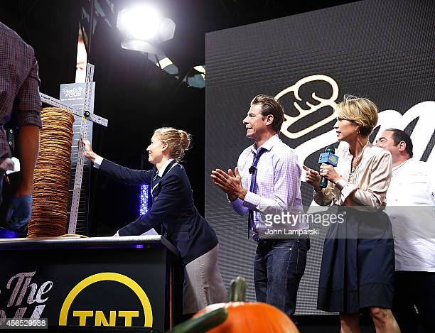 Adjudicator Morgan Wilbur Ty Pennington and ABC Anchor Amy Robach and Chef Emeril Lagasse attend the On The Menu Cooking Demo Guinness World Record...