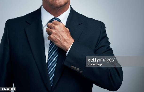 adjust what you need to - adjusting necktie stock pictures, royalty-free photos & images
