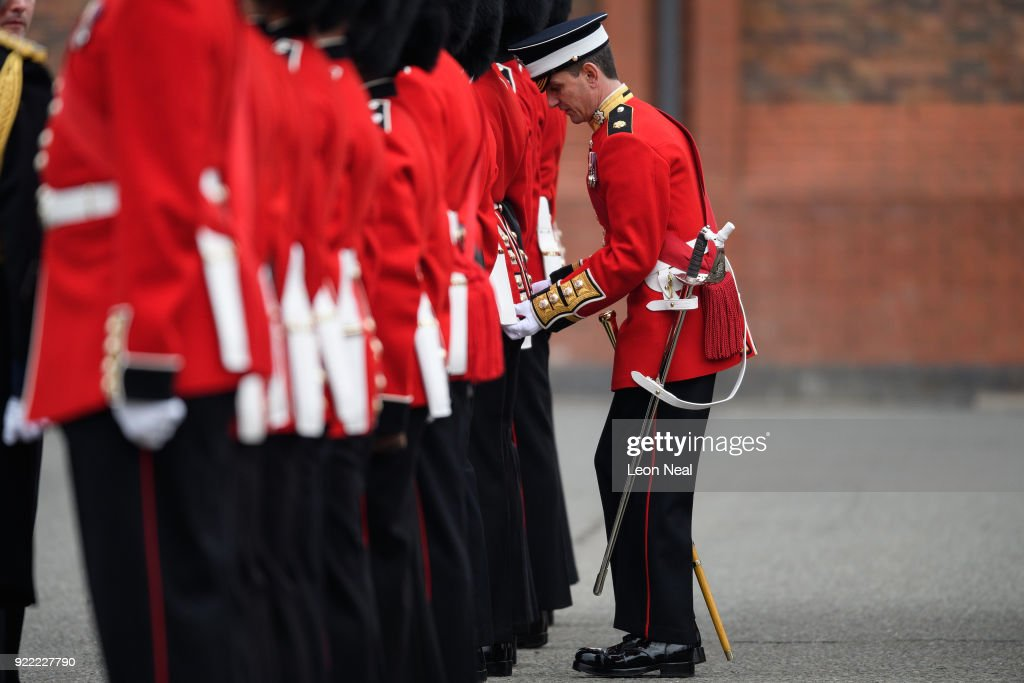 Adjustments are made to a Coldstream Guard soldier's uniform as they they take part in the annual Major General's Inspection at Victoria barracks on February 21, 2018 in Windsor, England. The inspection gives the Major General his first chance to check the presentation, uniforms and drill of the battalion, ahead of it's involvement in the Trooping the Colour Parade in London.