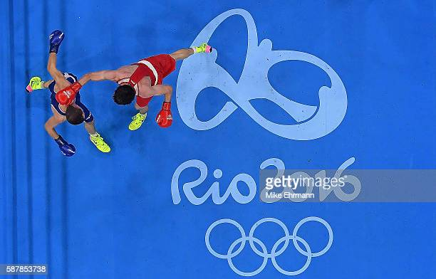 Adlan Abdurashidov of Russia fights against Reda Benbaziz of Algeria in their Mens Light weight 60kg bout on Day 4 of the Rio 2016 Olympic Games at...