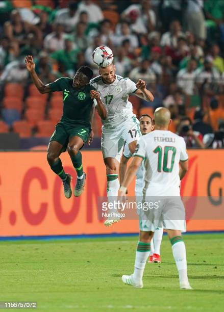 Adlane Guedioura of Algeria and Ahmed Musa of Nigeria challenging for the ball during the 2019 African Cup of Nations match between Algeria and...