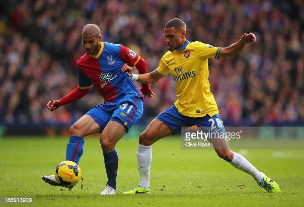 Adlene Guedioura of Crystal Palace is challenged by Kieran Gibbs of Arsenal during the Barclays Premier League match between Crystal Palace and...