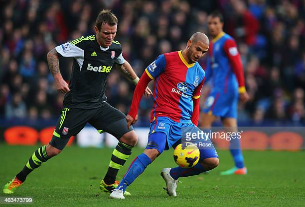 Adlene Guedioura of Crystal Palace is closed down by Glenn Whelan of Stoke City during the Barclays Premier League match between Crystal Palace and...