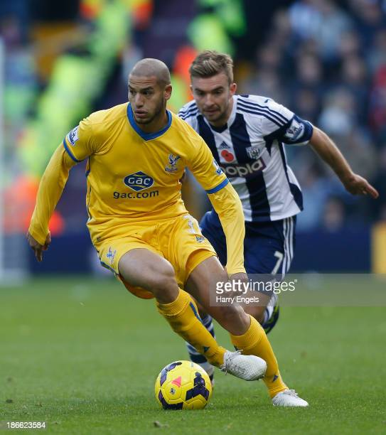 Adlene Guedioura of Crystal Palace runs away from James Morrison of West Brom during the Barclays Premier League match between West Bromwich Albion...