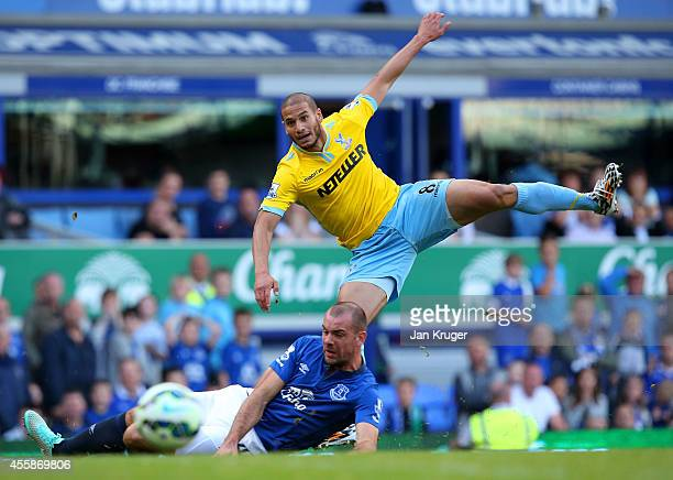Adlene Guedioura of Crystal Palace shoots on goal past Darron Gibson of Everton during the Barclays Premier League match between Everton and Crystal...
