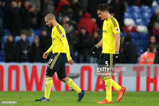 Adlene Guedioura of Middlesbrough and Bernardo Espinosa of Middlesbrough walk off dejected after the Premier League match between Crystal Palace and...