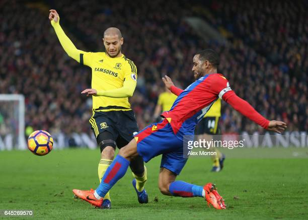Adlene Guedioura of Middlesbrough and Jason Puncheon of Crystal Palace battle for possession during the Premier League match between Crystal Palace...