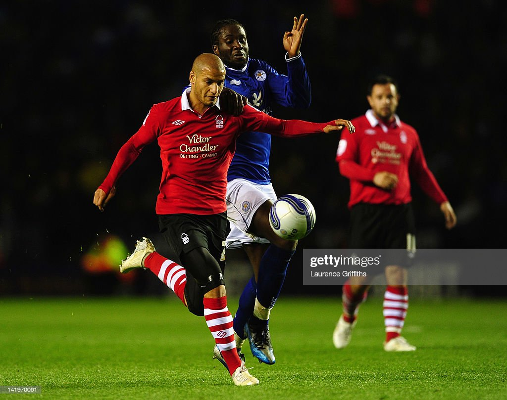Adlene Guedioura of Nottingham Forest battles with Sol Bamba of Leicester City during the npower championship match between Leicester City and Nottingham Forest at The King Power Stadium on March 27, 2012 in Leicester, England.