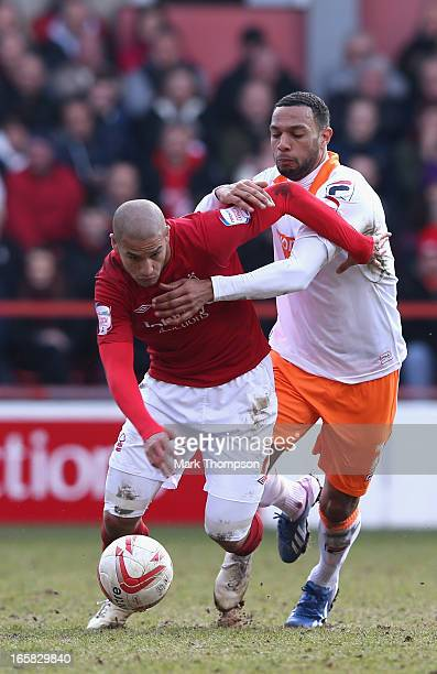 Adlene Guedioura of Nottingham Forest tangles with Matt Phillips of Blackpool during the npower Championship match between Nottingham Forest and...