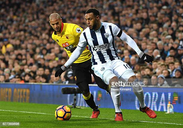 Adlene Guedioura of Watford and Matt Phillips of West Bromwich Albion compete for the ball during the Premier League match between West Bromwich...