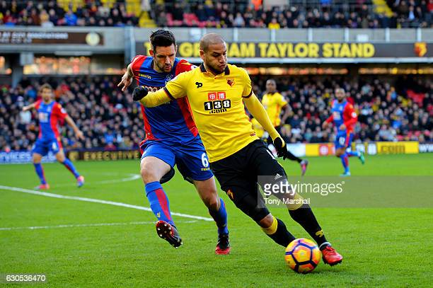 Adlene Guedioura of Watford battles for the ball with Scott Dann of Crystal Palace during the Premier League match between Watford and Crystal Palace...