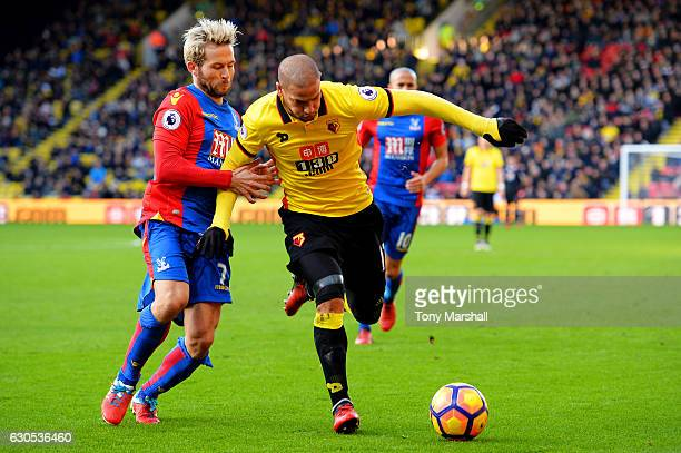 Adlene Guedioura of Watford battles for the ball with Yohan Cabaye of Crystal Palace during the Premier League match between Watford and Crystal...