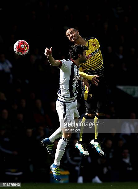 Adlene Guedioura of Watford competes for the ball with Claudio Yacob of WBA during the Barclays Premier League match between West Bromwich Albion and...