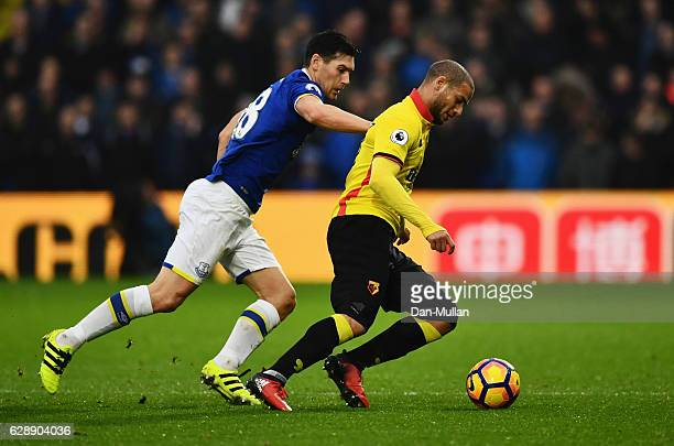 Adlene Guedioura of Watford holds off Gareth Barry of Everton during the Premier League match between Watford and Everton at Vicarage Road on...