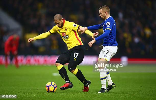 Adlene Guedioura of Watford holds off Gerard Deulofeu of Everton during the Premier League match between Watford and Everton at Vicarage Road on...