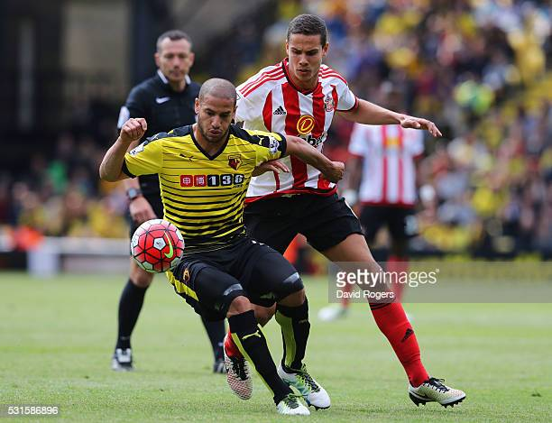 Adlene Guedioura of Watford holds off Jack Rodwell of Sunderland during the Barclays Premier League match between Watford and Sunderland at Vicarage...