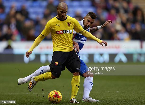 Adlene Guedioura of Watford holds off the challenge of Danny Williams of Reading during the Sky Bet Championship match between Reading and Watford at...