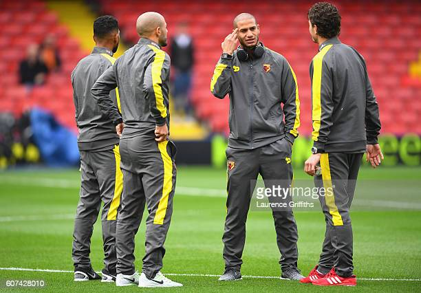 Adlene Guedioura of Watford speaks to his team mates on the pitch during the Premier League match between Watford and Manchester United at Vicarage...