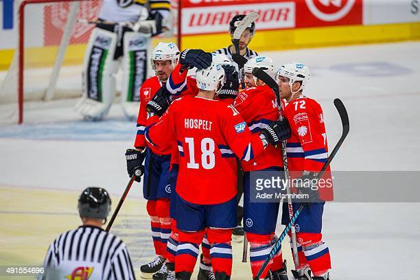 Adler Mannheim celebrates their first goal during the Champions Hockey League round of thirty-two game between Adler Mannheim and Espoo Blues at SAP...