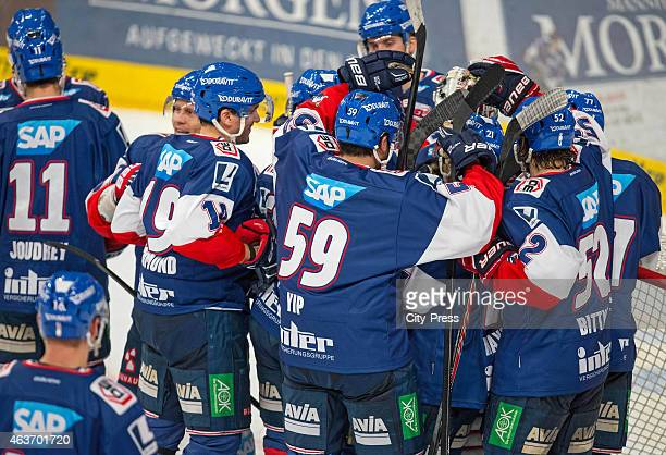 Adler Mannheim Team celebrates their home victory during the game between Adler Mannheim and Eisbaeren Berlin on February 17 2015 in Mannheim Germany