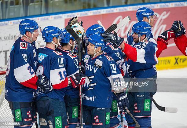Adler Team celebrates ihren home victory during the game between Adler Mannheim and Thomas Sabo Ice Tigers on March 11, 2015 in Mannheim, Germany.