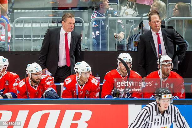 Adler Trainer Sean Simpson and Adler CoTrainer Steve Walker watch from the bench during the Champions Hockey League match between Adler Mannheim and...