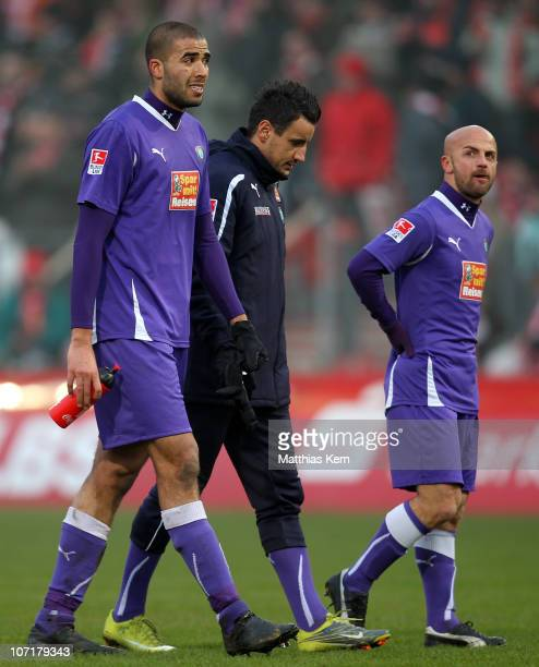 Adli Lachheb, Alban Ramaj and Skerdilaid Curri of Aue show their frustration after losing the Second Bundesliga match between FC Energie Cottbus and...