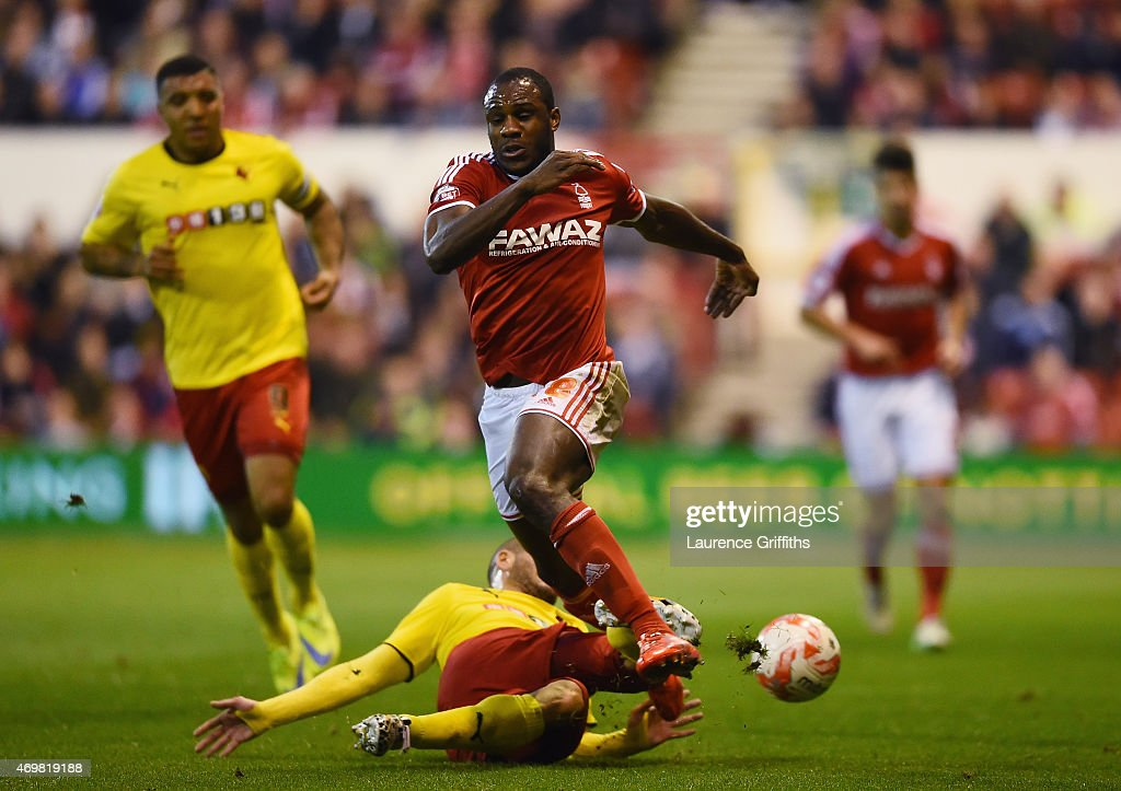 Adlène Guédioura of Watford tackles Michail Antonio of Nottingham Forest during the Sky Bet Championship match between Nottingham Forest and Watford at City Ground on April 15, 2015 in Nottingham, England.