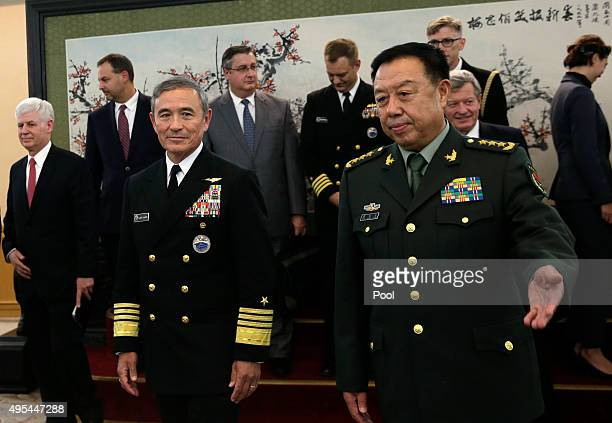 Adm Harry B Harris Jr US Navy Commander US Pacific Command left and Fan Changlong vicechairman of China's Central Military Commission right proceed...