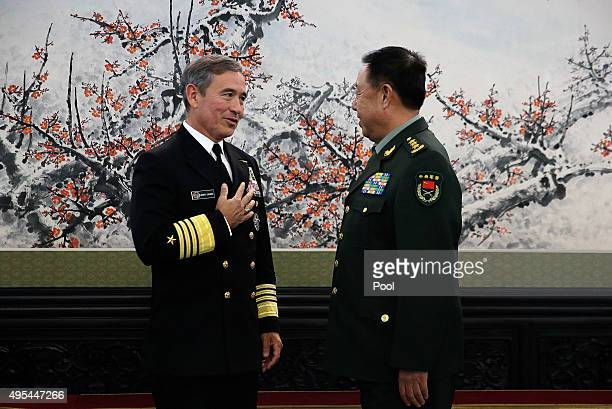 Adm Harry B Harris Jr US Navy Commander US Pacific Command left chats with Fan Changlong vicechairman of China's Central Military Commission before...