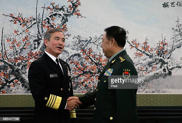 Adm Harry B Harris Jr US Navy Commander US Pacific Command left shades hands with Fan Changlong vicechairman of China's Central Military Commission...