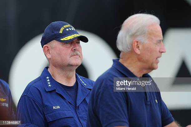 Adm. Thad Allen, left, looks on as Vice President Joe Biden addresses members of the media at a U.S. Naval Air Station in Pensacola, Florida, on...