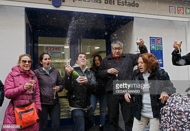 Administration Lottery owners and locals celebrate having sold a first prize ticket in Spain's Christmas lottery named El Gordo in Palencia on...