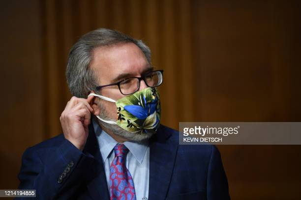 EPA Administrator Andrew Wheeler adjusts his mask at a hearing titled Oversight of the Environmental Protection Agency in the Dirksen Senate Office...