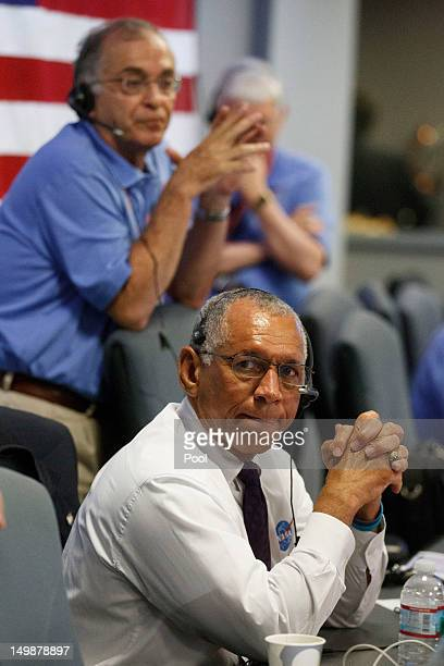 Administrator Charles Bolden clasps his hands as the rover begins its decent to the surface of mars, inside the Spaceflight Operations Facility for...