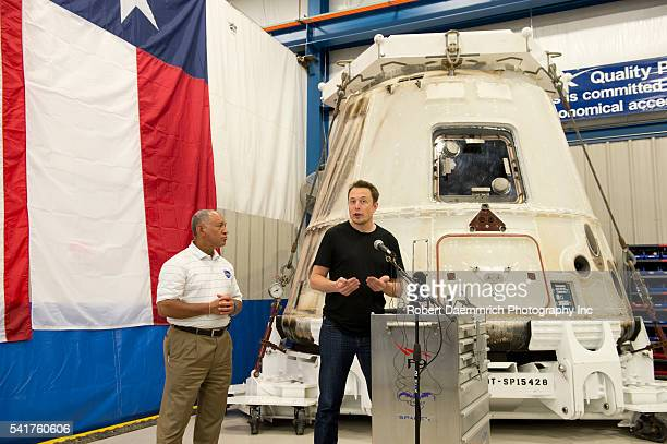 Administrator Charles Bolden, left, listens as SpaceX CEO and Chief Designer Elon Musk answers questions about the private Dragon spacecraft that...