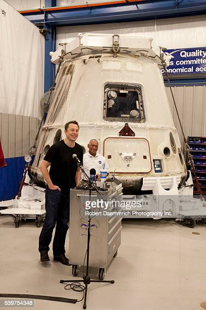 Administrator Charles Bolden, right, and SpaceX CEO and Chief Designer Elon Musk, left answer questions about the private Dragon spacecraft that...