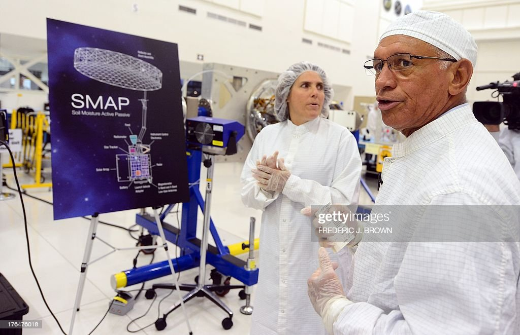 Administrator Charles Bolden tours the Spacecraft Assembly Facility Cleanroom at the Jet Propulsion Laboratory in Pasadena, California on August 13, 2013, to see the progress and assembly of the Soil Moisture Active Passive (SMAP) satellite presently under construction and due to launch in October 2014. SMAP will produce global maps of soil moisture for tracking water availability around the planet, and will also detect winter freeze and spring thaw to track changes in growing season patterns, allowing scientists to determine how much carbon plants take up from the atmosphere each year. AFP PHOTO/Frederic J. BROWN