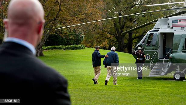 Administrator Craig Fugate and President Barack Obama walk toward Marine One where they will depart the White House to tour disasterstriken New...